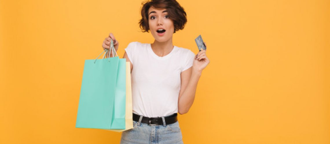 portrait-surprised-happy-woman-holding-shopping-bags_171337-6047