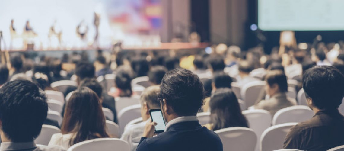rear-view-audience-listening-speakers-stage-conference-hall-seminar-meeting_41418-3389