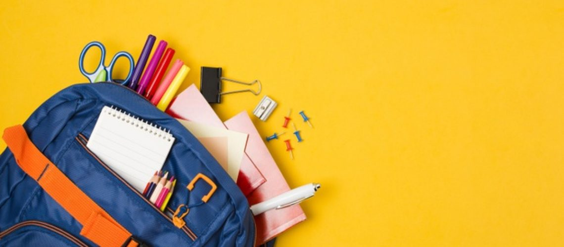yellow-copy-space-with-backpack-full-school-supplies_23-2148224289